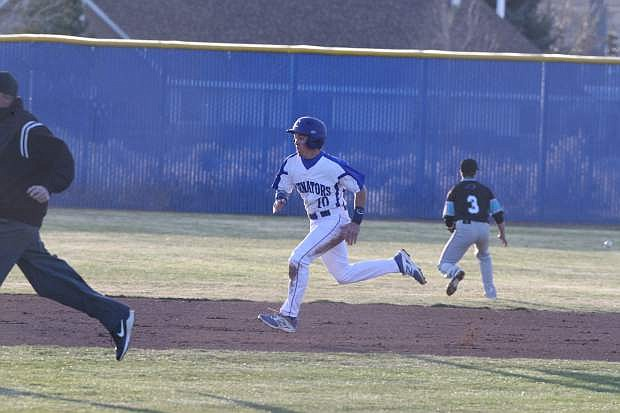 Gehrig Tucker out runs a relay throw to third base for a triple against North Valleys on Tuesday.