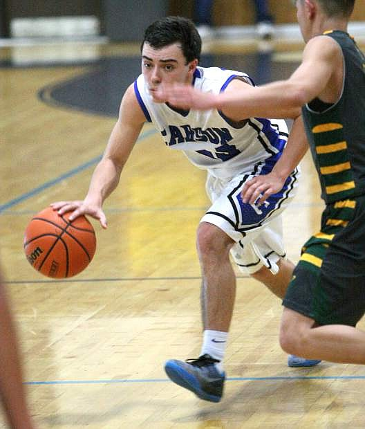 Guard Cody Azevedo brings the ball up the court against Manogue on Tuesday night.