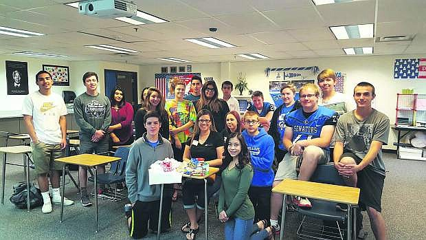 Angila Golik's Honors Government A1 class is assigned to help out with the Food For Thought charity. Pictured middle, sitting in the desk, is Executive Director Marlene Maffei.