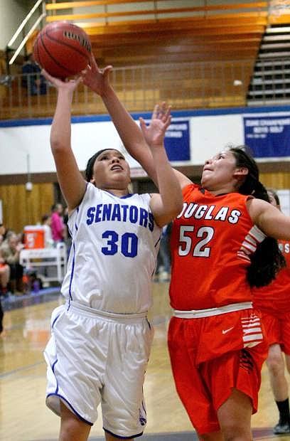 Brianna Alvarado drives to the basket against a Douglas defender on Tuesday night.