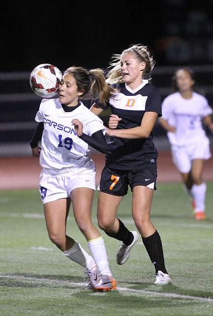 Julie Torres battles for the ball against a Douglas defender on Tuesday night.