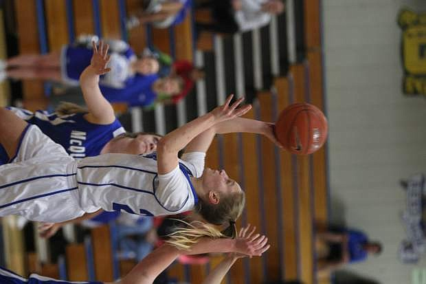 Carly Bachmann drives past a McQueen defender for a basket on Tuesday.