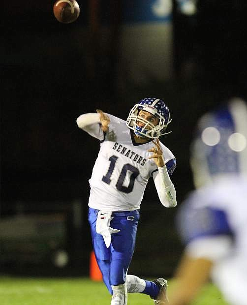 Nolan Shine hurls a bomb to one of his receivers Friday night at Hug.