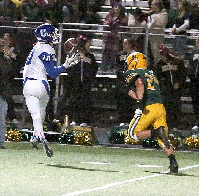 Wide reciver Brandon Gagnon hauls in a pass from Abel Carter during the third quarter. Carter is 3-for-3 on pass attempts this year.