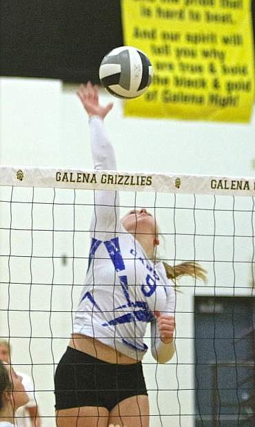 Carson's Maddie Jergesen nails one back over the net against Galena Thursday night in Reno.
