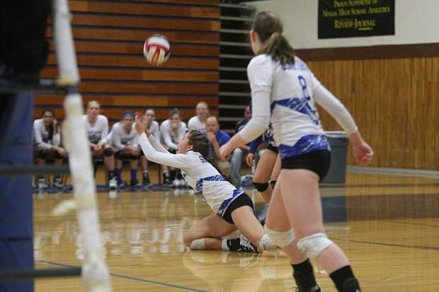 Jaycie Roberts dives to the floor for a dig against North Valleys on Tuesday night.