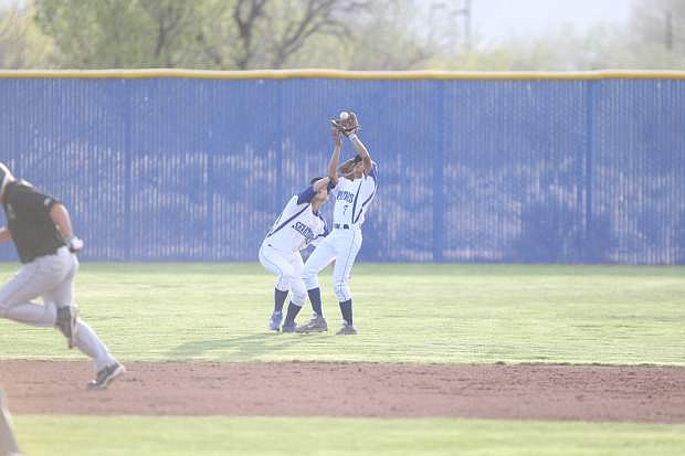 Shortstop Josiah Pongasi and left fielder Dustin Dutcher nearly collide on a shallow fly ball. Pongasi made the catch for the out against Hug on Tuesday.