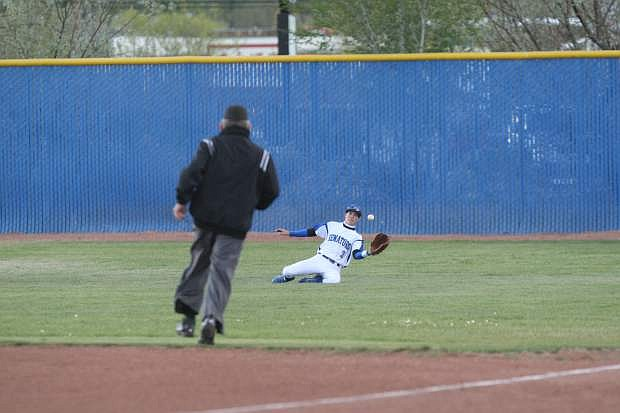 Dom Norton makes a sliding catch in right field against McQueen on Tuesday.