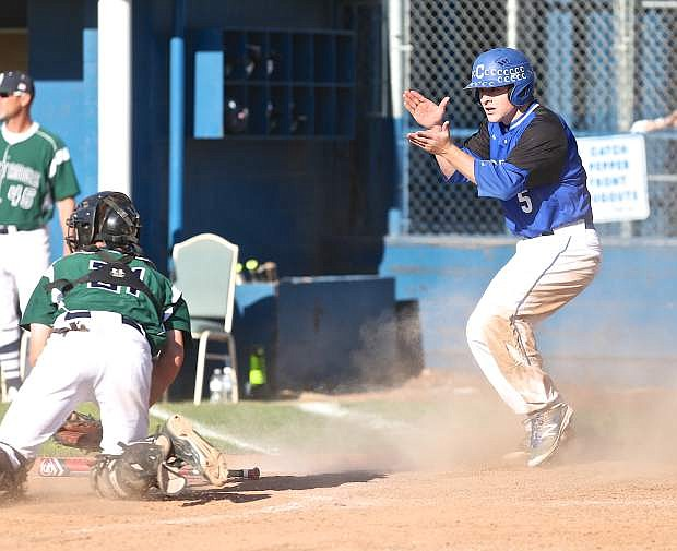Abel Carter slides safely past the Damonte catcher during a 6th inning Senator rally.