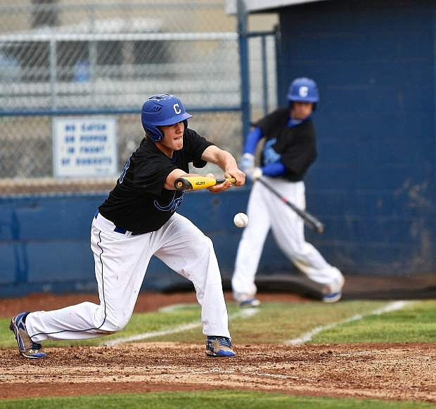 Bluejay Terek Been lays down a sacrafice bunt against McQueen Friday evening at Ron McNutt Field.