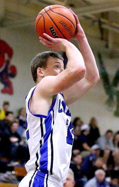 Carson's Asa Carter takes a jump shot during Tuesday's game at Carson High against Damonte Ranch.