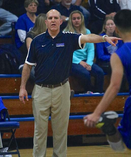 Carson Head Coach Carlos Mendeguia directs his players against Reed Wednesday night at Morse Burley Gymnasium.