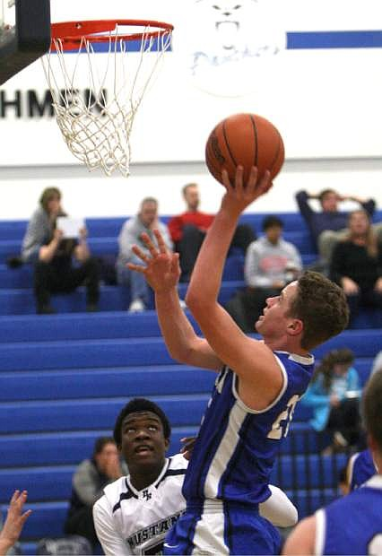 Tez Allen drives to the basket against Damonte Ranch on Tuesday.