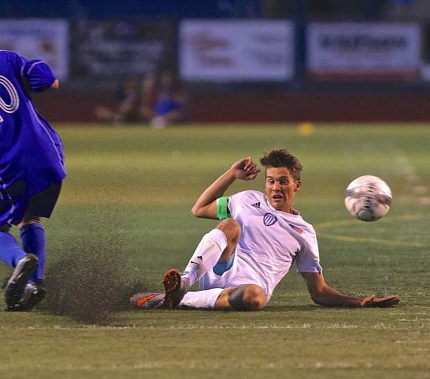 Carson's Peter Garrett makes a sliding defensive play in a game last year at Carson High.