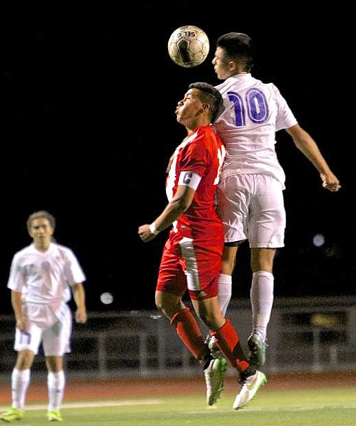 Senator Guillermo Hernandez-Galvan (10) heads the ball near midfield in a battle with Wooster Wednesday night at Carson High.