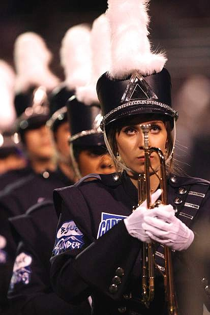 The Carson High marching band performs at halftime Friday night.