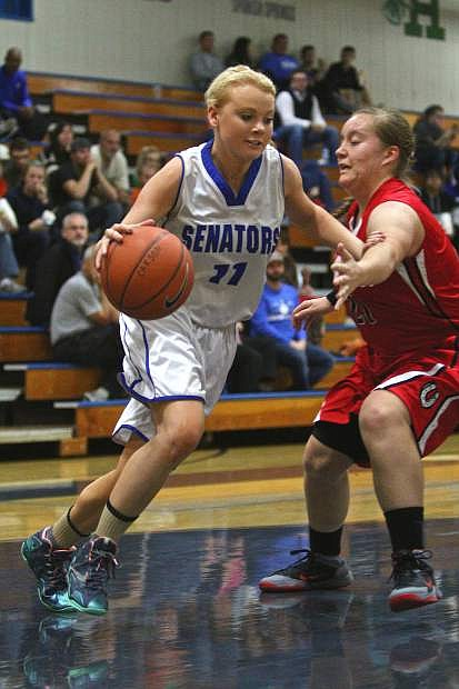Senior power forward Kayla Aikins (11) moves past a Wooster player Friday night in a win against the Colts at home.