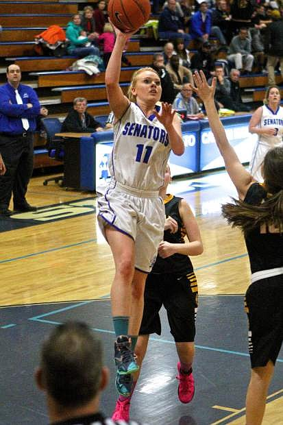 Senior Kayla Aikins puts up a shot in a 1-point loss to Galena Friday night at Morse Burley Gym.