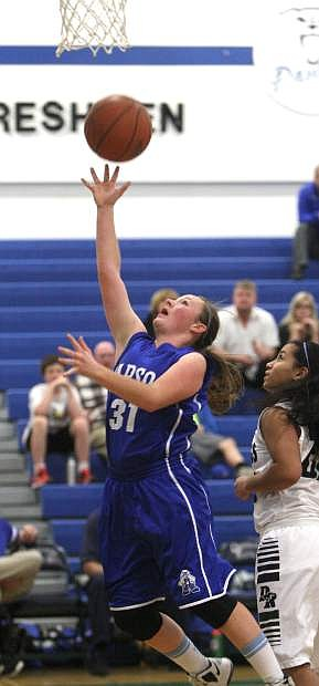 Melissa Glanzmann drives to the basket during a game last season.