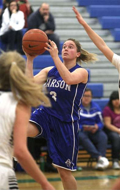 Michelle Perry drives to the basket against Damonte Ranch on Tuesday.