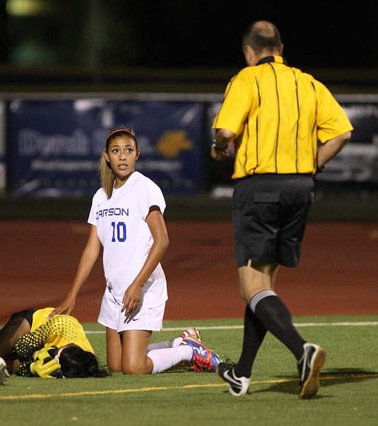 Galilea Cid checks on Manogue goalie Ramneek Dhami after she scored a goal while colliding with the goalie.