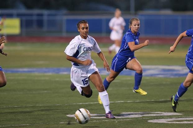 Carson's Josilyn Daggs brings the ball up the field against McQueen on Tuesday.