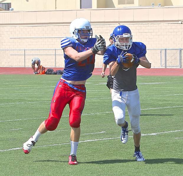 Carson defensive back Connor Pradere gets a pick-six during a scrimmage against the Reno Huskies Saturday at CHS.