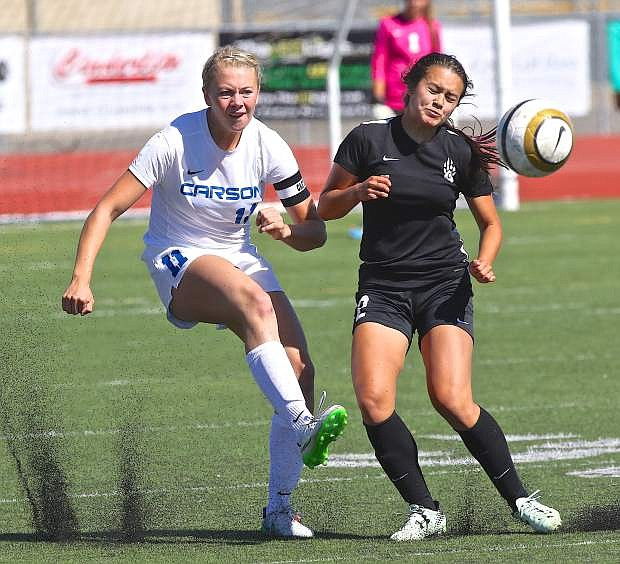 Carson senior Lindy Lehman battles for possesion with a Galena player Saturday afternoon at Carson High School.