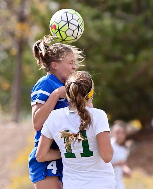 Senior Lauren Hudak heads the ball in a game against the Manogue Miners Saturday in Reno.