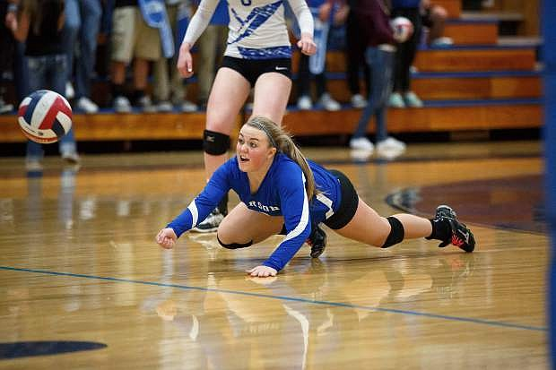 Carson High's Makenzie Tucker dives for a ball against Reno Tuesday night at Carson High School. The Senators advanced to the semifinals of the Division 1 volleyball playoffs.
