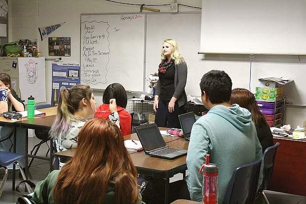 Jennifer Kluever, Carson High School class of 2012 and floral designer at Michaels Craft Store, addresses the CHS Career and Technical Education floriculture class.