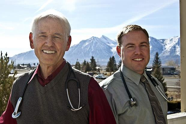 Dr. David H. Johnson, left, and his son, Dr. David A. Johnson, who was recently honored as Physician of the Year from Healogics, a network of wound care services.