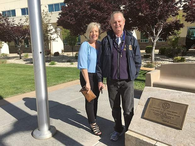 Kitty McKay, director of customer experience at Carson Tahoe Health, stands with Eric Nelson, president of the Carson City Sunset Rotary, following the installation of three new benches at the hospital. The donation is courtesy of Rotary.