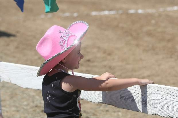 Four-year-old Zoey Brown watches the races at the International Camel and Ostrich Races in Virginia City on Friday.