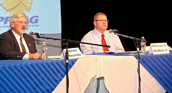 School Board trustee candidates Steven Reynolds and Michael B. Walker speak at the Brewery Arts Center Wednsday evening.