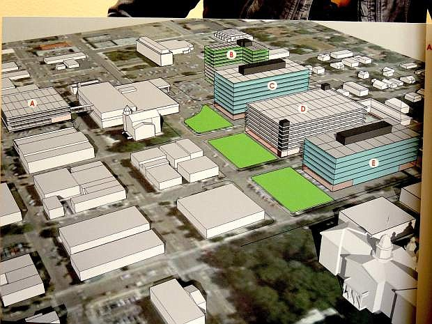 A 10.5-acre Carson City Capitol Mall project with a 10-story hotel, multi-story office structures and parking garages moved from the drawing board to city government Thursday. This drawing was the first proposed project.