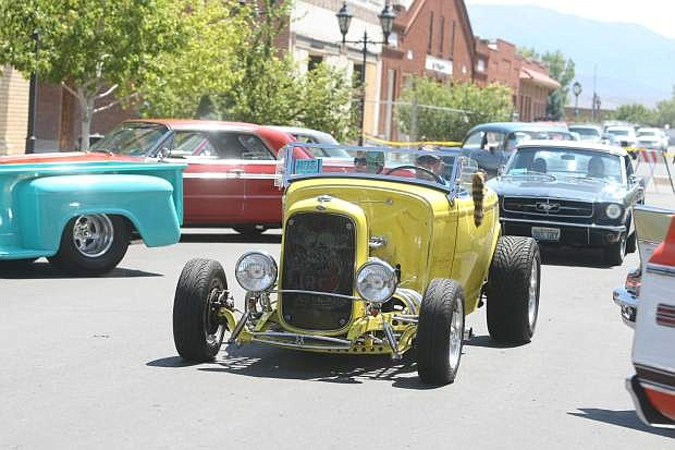 A 1932 Ford Roadster drives on Esmeralda Avenue during last year's Hot August Nights poker run.