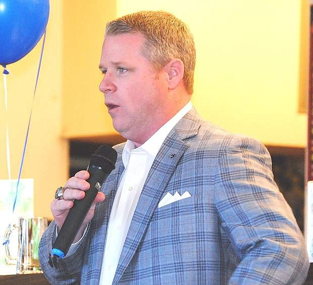 Nevada Athletic Director Doug Knuth speaks with Carl, left, and Jerome Chandler during Wednesday's Wolf Pack Coaches Caravan at Pizza Barn.