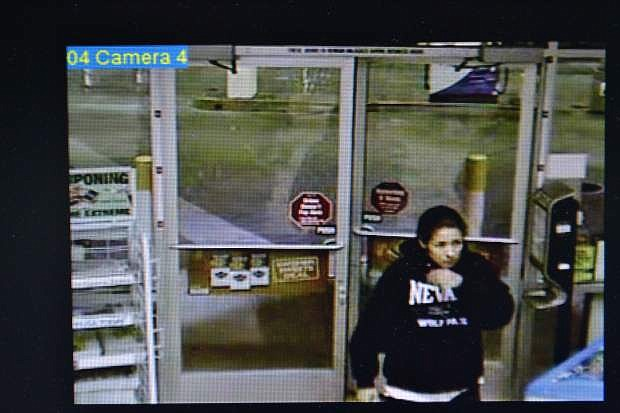 This is a surveillance image from Reno gas station where a victim's credit card was used to withdraw about $6,500 from an ATM.