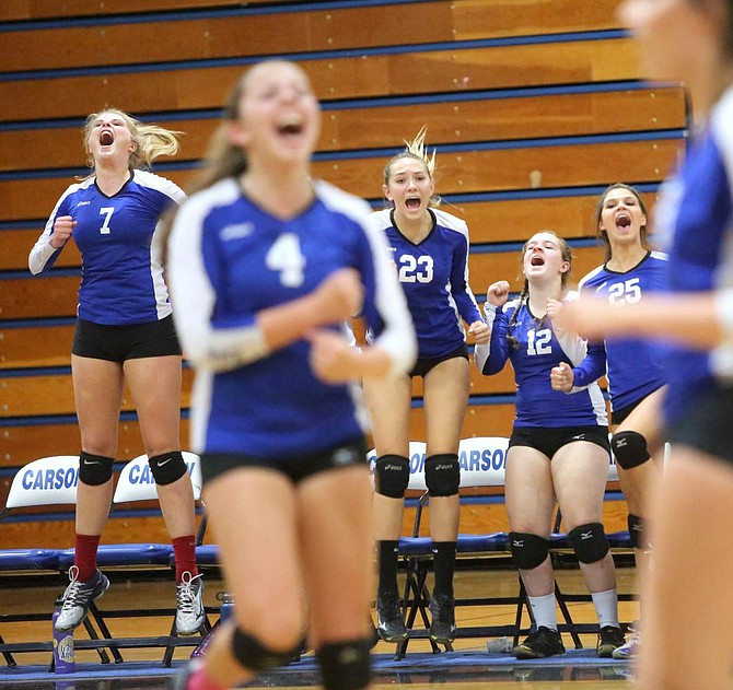Carson celebrates a third game victory in a match against Douglas on Tuesday night.