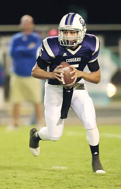 Spanish Springs quarterback Hunter Fralick has thrown from 2,028 yards and 11 touchdowns this year. Carson will host Fralick and the Cougars on Friday.
