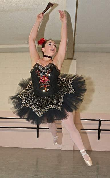 """Kate Frels leaps into the air during rehearsal for """"The Nutcracker."""""""