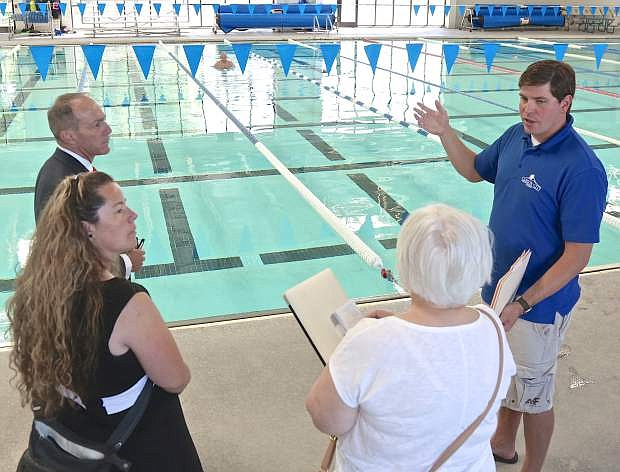 Mike Freeman of the Carson Aquatic Facility speaks with Appeal reporter Anne Knowles, Parks, Recreation and Open Spaces Director Jennifer Budge and Carson City Manager Nick Marano Thursday about planned maintenance and upgrades.