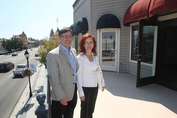 Carson City Square professional building owners Steve and Wendy Kaplan stand on a deck, that is accessed through an vacant office space.