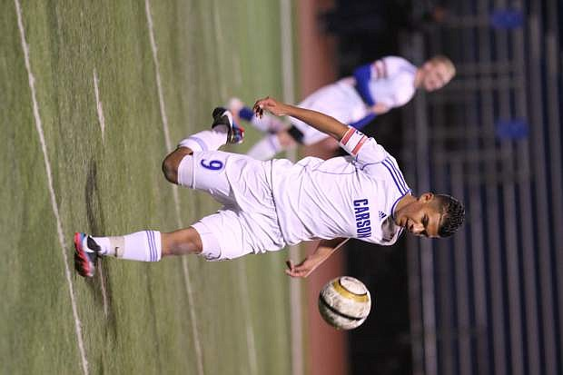 Cristian Hernandez runs down the ball in a playoff game against North Valleys on Tuesday.
