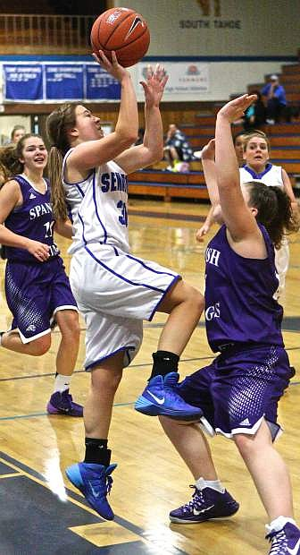 Junior guard Andrea Maffei puts up a shot and ends up getting fouled in the process at CHS Thursday night. The Senators defeated the Spanish Springs Cougars 41-25,