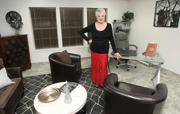 Executive Director Ronni Hannaman poses in her new office at the Carson City Chamber of Commerce on Tuesday. .