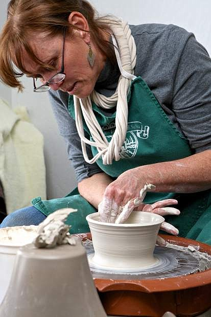 Linda Ritter of Pinyon Pottery works clay on the potter's wheel Saturday afternoon at the Carson City Chamber of Commerce's 'Meet The Artist' event at the Chamber Artisan Store at 1900 S. Carson St.