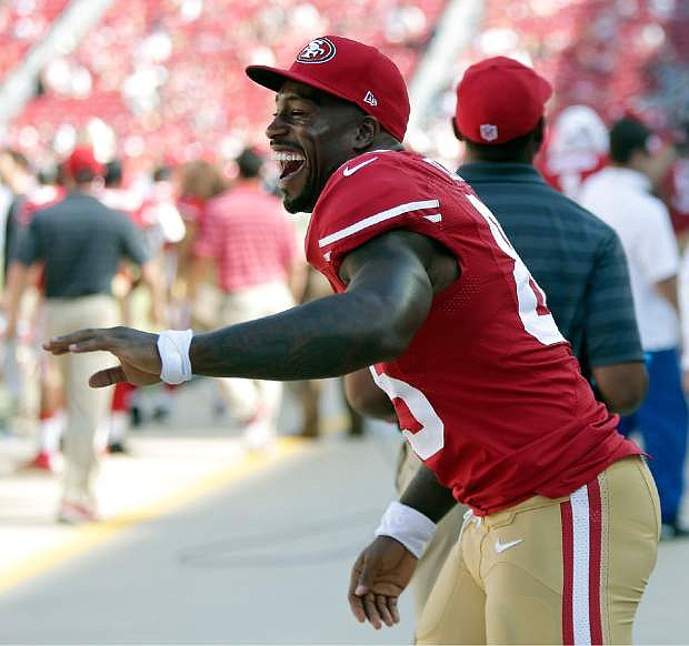 San Francisco 49ers tight end Vernon Davis celebrates on the sideline during the fourth quarter of an NFL preseason football game against the San Diego Chargers in Santa Clara, Calif., Sunday, Aug. 24, 2014. The 49ers won 21-7. (AP Photo/Marcio Jose Sanchez)