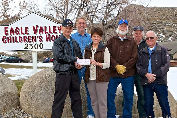 The Dayton Knights of Columbus from St. Anne's Catholic Church in Dayton donate $1,600 on Thursday to the Eagle Valley Children's Home from their annual Tootsie Roll Drive. Pictured here are Ken Broadway, EVCH Exec. Director Beverly Hennen, Gene Kinney, Gene Ray, Patrick Neylan and Vincent DeCasper.